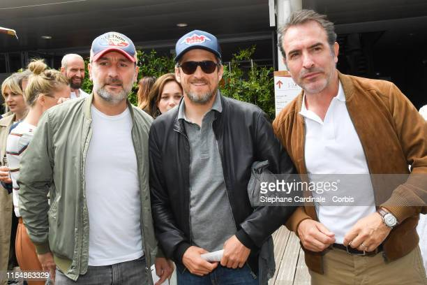 Gilles Lellouche Guillaume Canet and Jean Dujardin attend the 2019 French Tennis Open Day Fifteenth at Roland Garros on June 09 2019 in Paris France