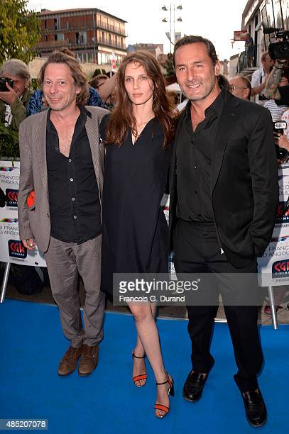 Gilles Lellouche Marine Vacth and Mathieu Amalric pose during the 'Belles Familles' photocall as part of the 8th Angouleme FrenchSpeaking Film...