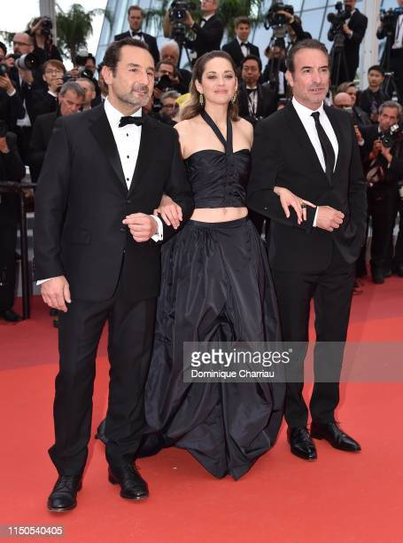 Gilles Lellouche Marion Cotillard and Jean Dujardin attend the screening of La Belle Epoque during the 72nd annual Cannes Film Festival on May 20...