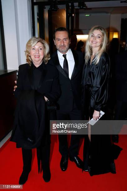Gilles Lellouche standing between his mother and Alizee Guinochet attend the Cesar Film Awards 2019 at Salle Pleyel on February 22 2019 in Paris...