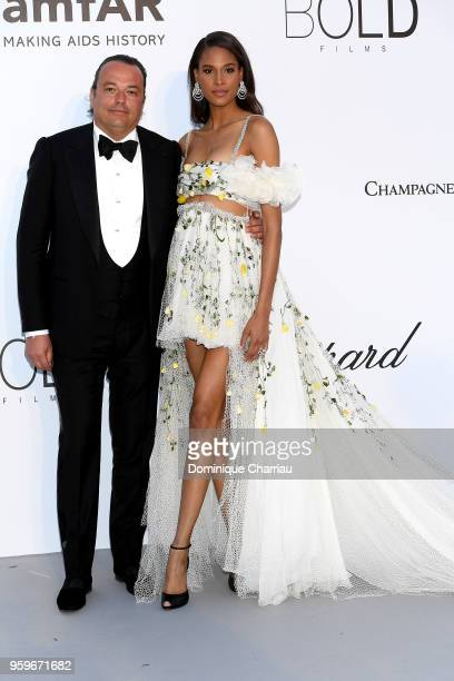 Gilles Mansard and Cindy Bruna arrive at the amfAR Gala Cannes 2018 at Hotel du CapEdenRoc on May 17 2018 in Cap d'Antibes France