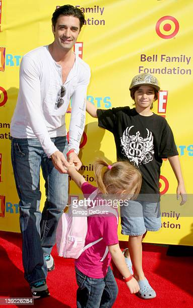 Gilles Marini daughter Juliana and son Georges arrive at PS Arts Express Yourself 2009 at Barker Hangar on November 15 2009 in Santa Monica California