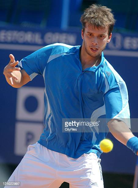 Gilles Muller hits a forehand during a match against Christophe Rochus in the first round of the Estoril Open Estoril Portugal on May 1 2006