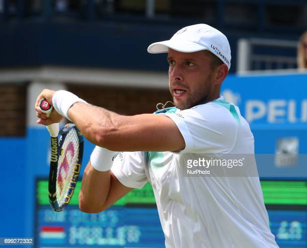 Gilles Muller LUX against Jo-Wilfried Tsonga FRA during Round Two match on the third day of the ATP Aegon Championships at the Queen's Club in west...
