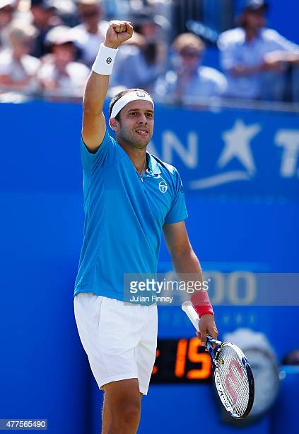 Gilles Muller of Luxembourg celebrates victory in his men's singles second round match against Grigor Dimitrov of Bulgaria during day four of the...