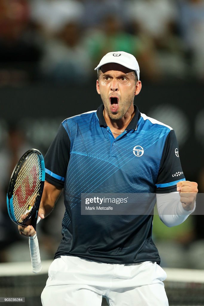 Gilles Muller of Luxembourg celebrates winning set point in his second round match against John Millman of Australia during day four of the 2018 Sydney International at Sydney Olympic Park Tennis Centre on January 10, 2018 in Sydney, Australia.