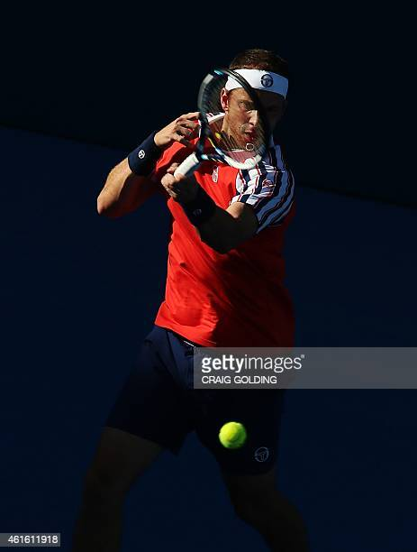 Gilles Muller of Luxembourg hits a return against Viktor Troicki of Serbia during their men's singles semi-final match on day six of the Sydney...