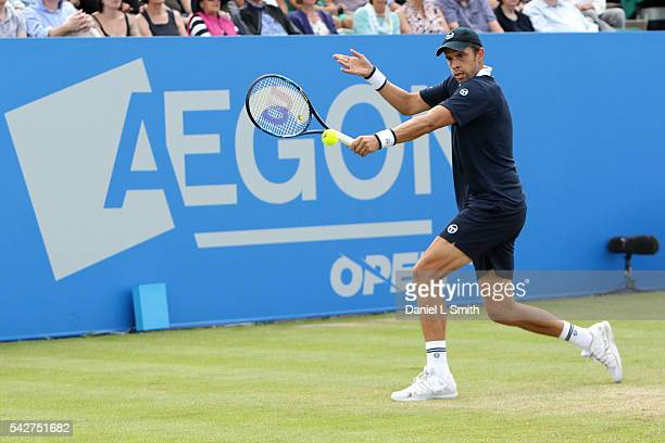 Gilles Muller of Luxembourg plays a backhand during his men's singles semifinal match against Pablo Cuevas of Uruguay during day five of the ATP...