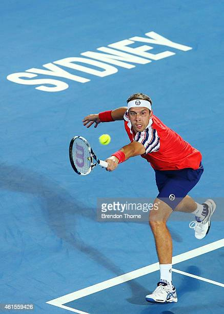 Gilles Muller of Luxembourg plays a backhand in his quarter final match against Bernard Tomic of Australia during day five of the Sydney...