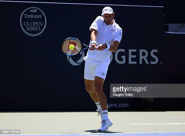 Gilles Muller of Luxembourg plays a shot against Novak Djokovic of Serbia on Day 3 of the Rogers Cup at the Aviva Centre on July 27 2016 in Toronto...