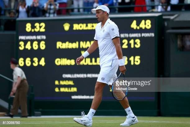 Gilles Muller of Luxembourg reacts after match point and victory after the Gentlemen's Singles fourth round match against Rafael Nadal of Spain on...