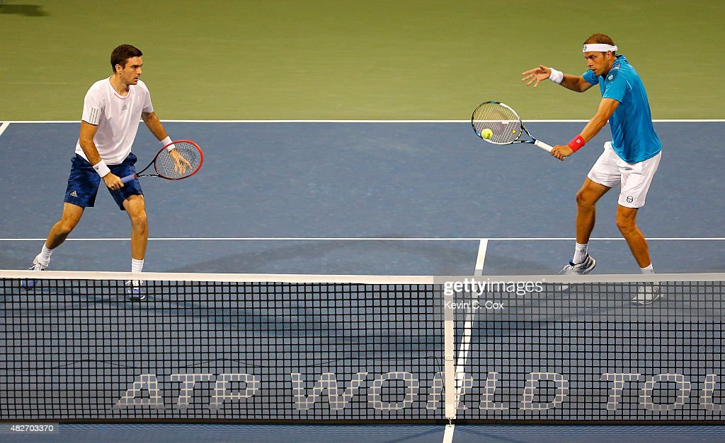 Gilles Muller of Luxembourg returns a backhand to Artem Sitak of New Zealand and Eric Butorac during the BB&T Atlanta Open at Atlantic Station on August 1, 2015 in Atlanta, Georgia.