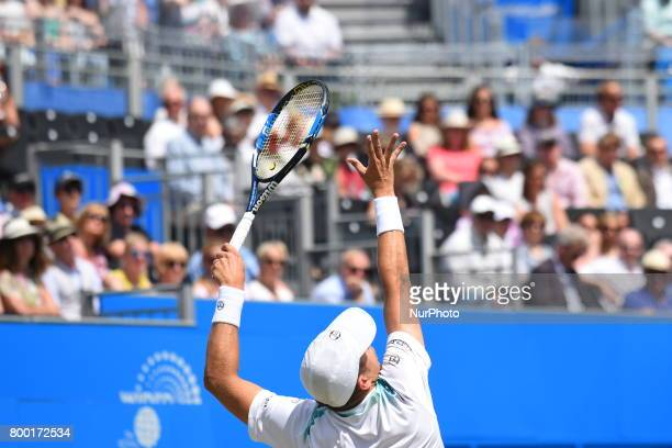 Gilles Muller of Luxembourg serve in the AEGON Championships 2017 quarter final at the Queen's Club, London on June 23, 2017.