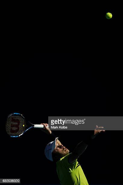 Gilles Muller of Luxembourg serves in his second round match against Milos Raonic of Canada on day four of the 2017 Australian Open at Melbourne Park...