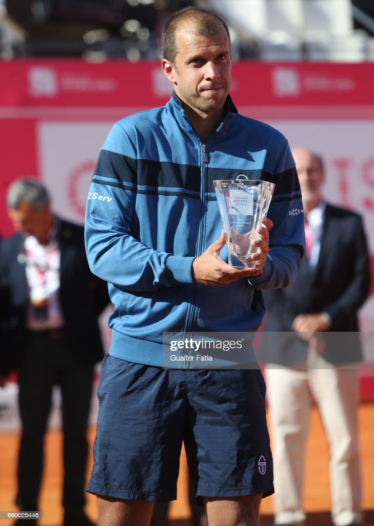 Gilles Muller pose for a photo with the runner up trophy at the end of the Final match between Pablo Carreno Busta from Spain and Gilles Muller from Luxembourg for the Millennium Estoril Open at Clube de Tenis do Estoril on May 7, 2017 in Estoril, Portugal.