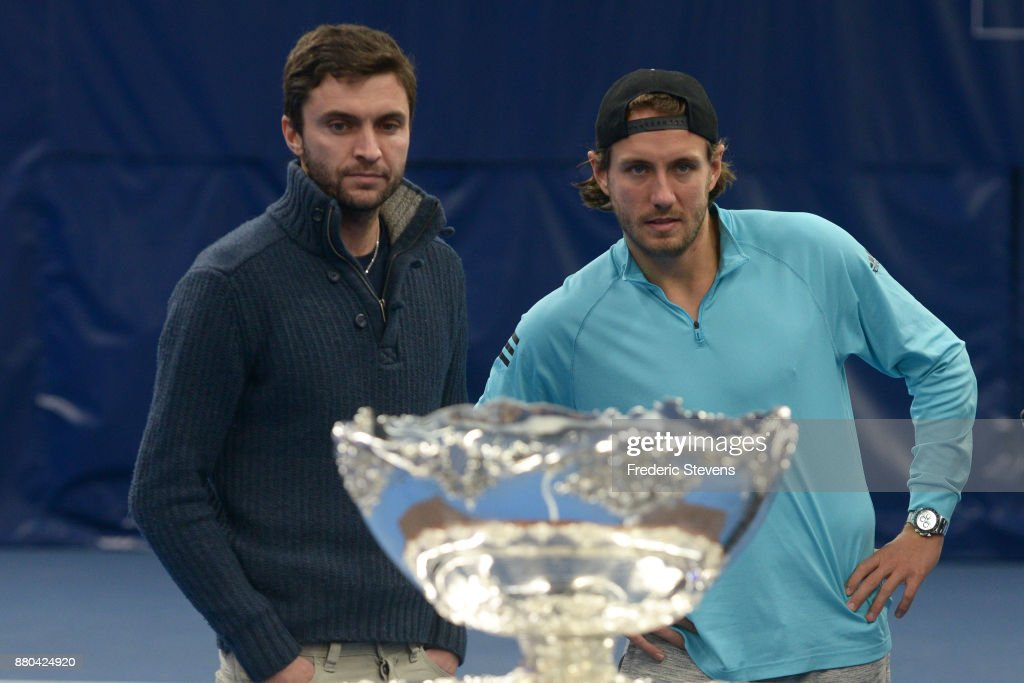 Gilles Simon, Lucas Pouille pose with the Davis Cup after victory over Belgium at the weekend in Villeneuve d'Ascq, on November 27, 2017 in Paris, France.