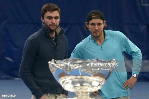 Gilles Simon Lucas Pouille pose with the Davis Cup after victory over Belgium at the weekend in Villeneuve d'Ascq on November 27 2017 in Paris France