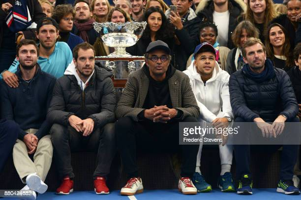 Gilles Simon Lucas Pouille Richard Gasquet Yannick Noah Jo Wilfried Tsonga Julien Benneteau pose with the Davis Cup after victory over Belgium at the...