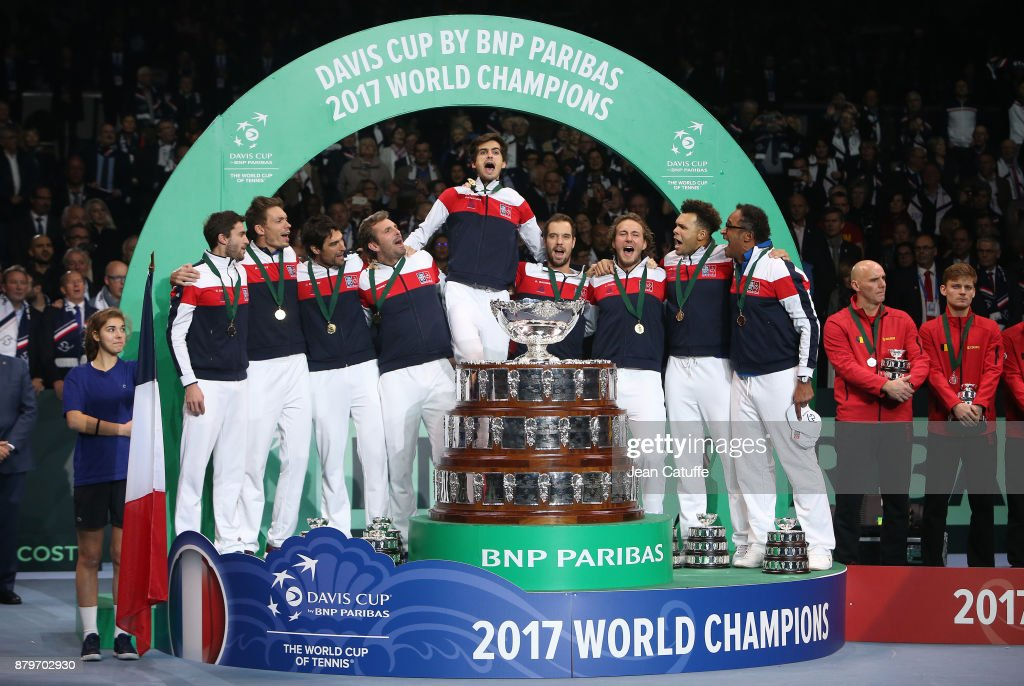 Gilles Simon, Nicolas Mahut, Jeremy Chardy, Julien Benneteau, Pierre-Hughes Herbert, Richard Gasquet, Lucas Pouille, Jo-Wilfried Tsonga, captain of France Yannick Noah celebrate winning the Davis Cup during the trophy presentation on day 3 of the Davis Cup World Group final between France and Belgium at Stade Pierre Mauroy on November 26, 2017 in Lille, France.