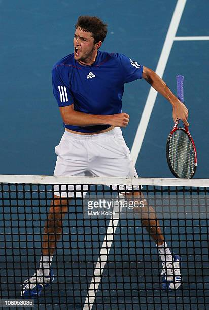 Gilles Simon of France celebrates winning the men's final match against Viktor Troicki of Serbia during day seven of the 2011 Medibank International...