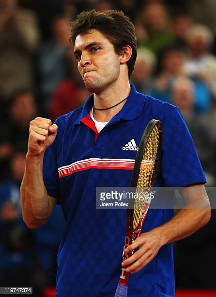 Gilles Simon of France celebrates with the cup after winning his final match against Nicolas Almagro of Spain during the bet-at-home German Open...