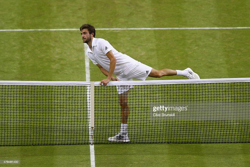 Gilles Simon of France crosses the net after victory in his Mens Singles Third Round match to console Gael Monfils of France during day six of the Wimbledon Lawn Tennis Championships at the All England Lawn Tennis and Croquet Club on July 4, 2015 in London, England.