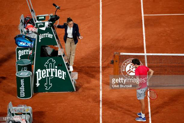 Gilles Simon of France has a conversation with Chair Umpire Marijana Veljovic about a ball she called out during his Men's Singles first round match...