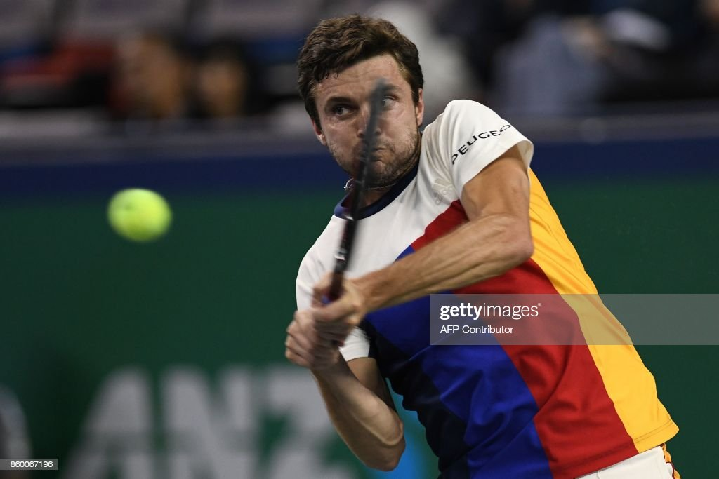 Gilles Simon of France hits a return during the men's 2nd round singles match against David Goffin of Belgium at the Shanghai Masters tennis tournament in Shanghai on October 11, 2017. /