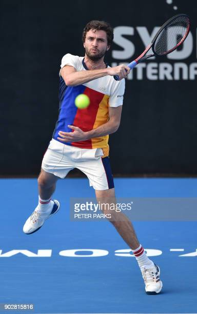 Gilles Simon of France hits a return to Jared Donaldson of the US in their men's singles first round match at the Sydney International tennis...