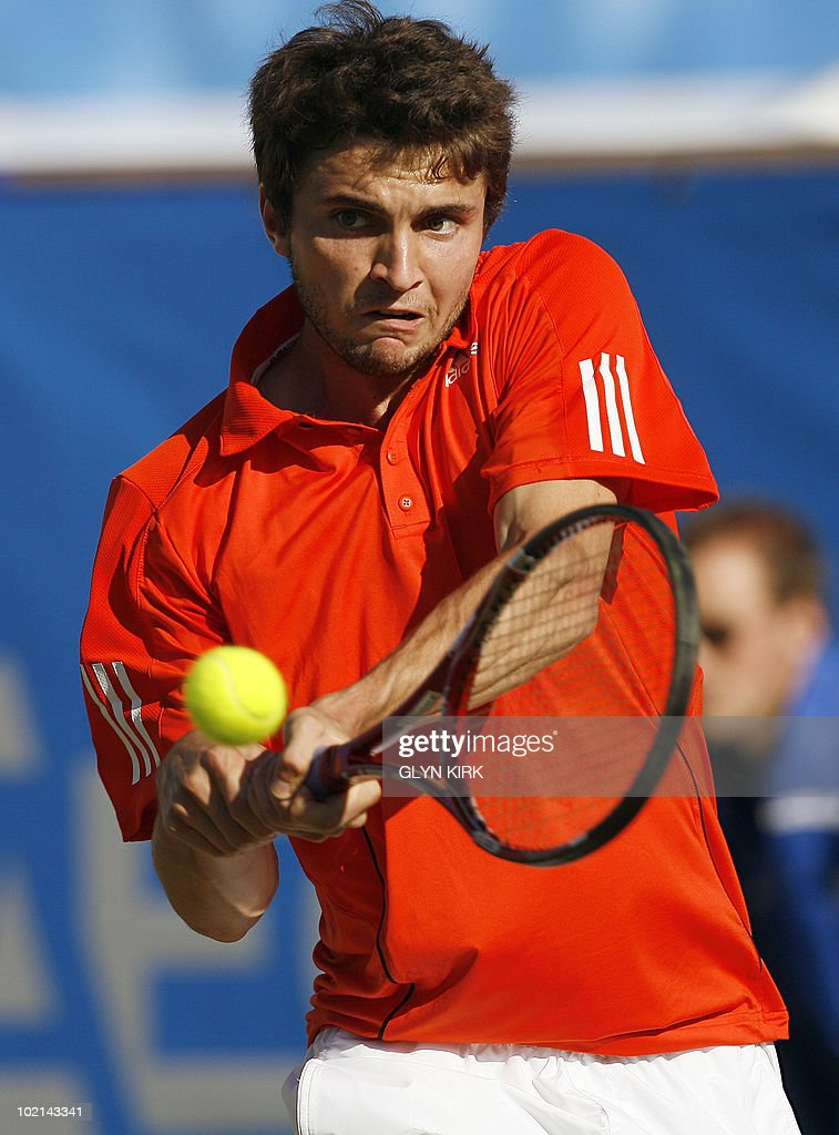 Gilles Simon of France hits a shot during his men's second round single match against Andrey Kuznetsov of Russia on the third day of the AEGON International tennis tournament in Eastbourne, southern England, on June 16, 2010.