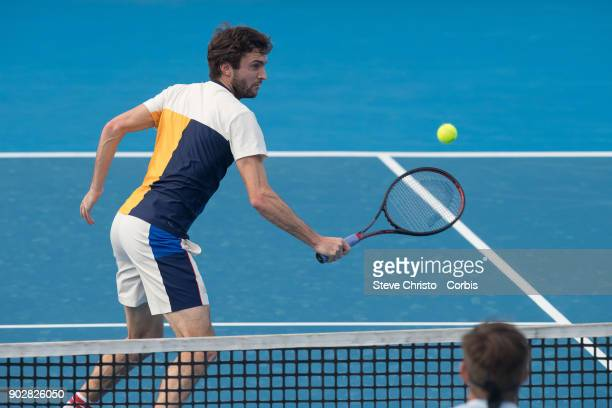 Gilles Simon of France hits the ball at Donaldson of the United States in his first round match during day three of the 2018 Sydney International at...