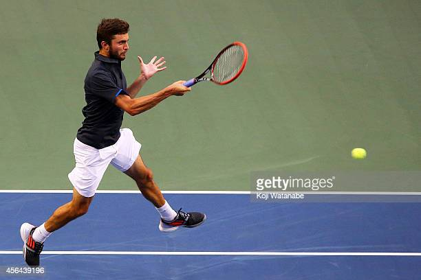 Gilles Simon of France in action during the men's singles second round match against Gilles Muller of Germany on day three of Rakuten Open 2014 at...