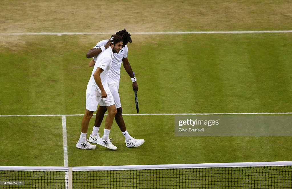 Gilles Simon of France is congratulated by Gael Monfils of France after their Mens Singles Third Round during day six of the Wimbledon Lawn Tennis Championships at the All England Lawn Tennis and Croquet Club on July 4, 2015 in London, England.