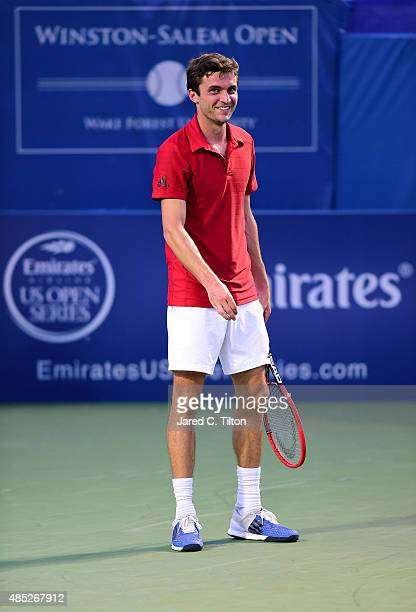 Gilles Simon of France looks on during his match against Aljaz Bedene of Great Britain during the second day of the Winston-Salem Open at Wake Forest...