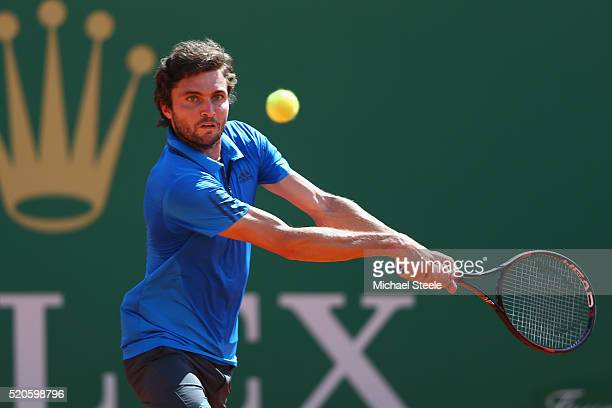Gilles Simon of France makes a return during his 64 63 victory against Grigor Dimitrov of Bulgaria during day three of the Monte Carlo Rolex Masters...