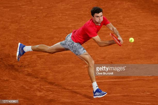 Gilles Simon of France plays a backhand during his Men's Singles first round match against Denis Shapovalov of Canada on day three of the 2020 French...