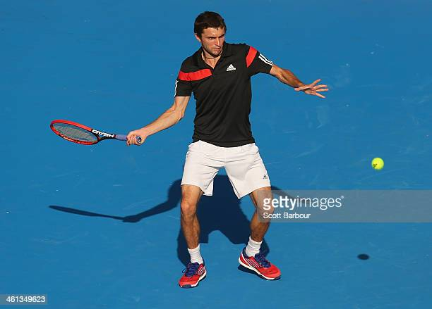 Gilles Simon of France plays a forehand during his match against Stanislas Wawrinka of Switzerland during day one of the 2014 AAMI Classic at Kooyong...