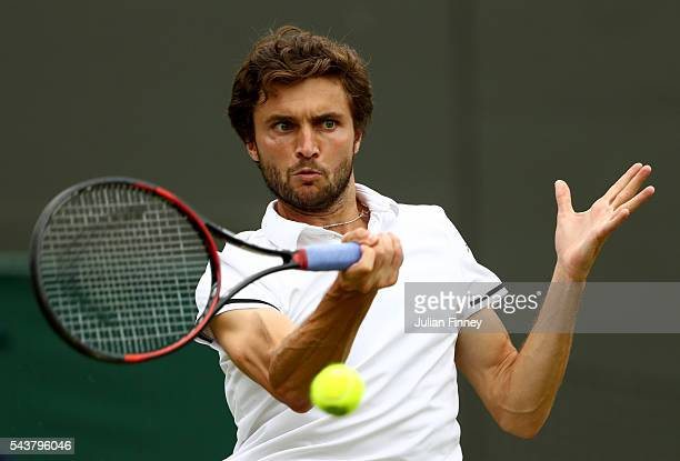 Gilles Simon of France plays a forehand during the Men's Singles second round match against Grigor Dimitrov of Bulgaria on day four of the Wimbledon...