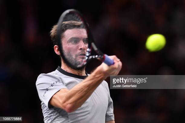 Gilles Simon of France plays a forehand in his second round match against Dominic Thiem of Austria during Day 3 of the Rolex Paris Masters on October...