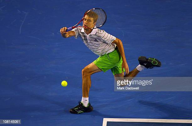 Gilles Simon of France plays a forehand in his second round match against Roger Federer of Switzerland during day three of the 2011 Australian Open...