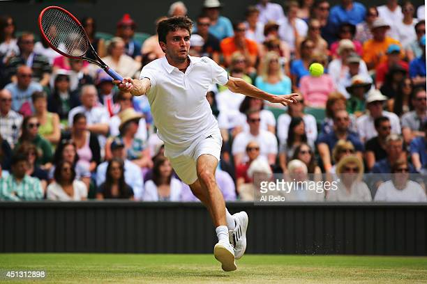 Gilles Simon of France plays a forehand return during his Gentlemen's Singles third round match against Novak Djokovic of Serbia on day five of the...