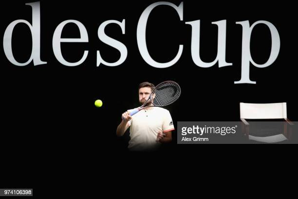 Gilles Simon of France plays a forehand to Feliciano Lopez of Spain during day 4 of the Mercedes Cup at Tennisclub Weissenhof on June 14 2018 in...
