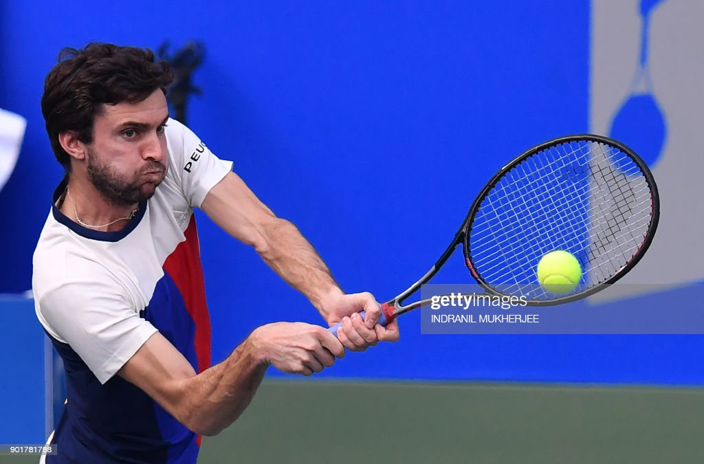 Gilles Simon of France plays a shot against Kevin Anderson of South Africa during the men's singles final of the Tata Open Maharashtra ATP tennis tournament at the Balewadi Stadium in Pune on January 6, 2018. /