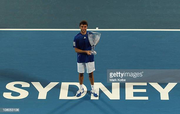 Gilles Simon of France poses with the trophy after winning the men's final match against Viktor Troicki of Serbia during day seven of the 2011...