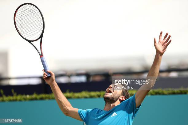 Gilles Simon of France reacts after loosing a point during his Quarter-Final Singles Match against Nicolas Mahut of France during day Five of the...