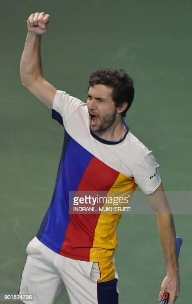 Gilles Simon of France reacts after winning against Kevin Anderson of South Africa during the men's single final of the Tata Open Maharashtra ATP...