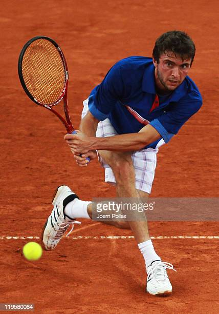 Gilles Simon of France returns a backhand during his quarter final match against Gael Monfils of France during the betathome German Open Tennis...