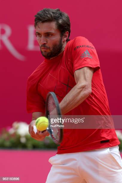 Gilles Simon of France returns a ball to Pedro Sousa of Portugal during the Millennium Estoril Open ATP 250 tennis tournament round 1 at the Clube de...