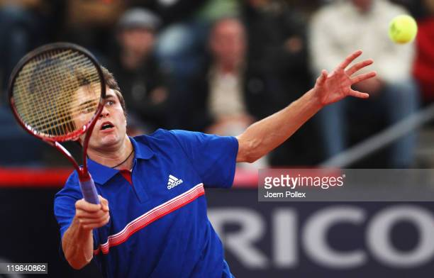 Gilles Simon of France returns a forehand during his semi final match against Mikhail Youzhny of Russia during the bet-at-home German Open Tennis...