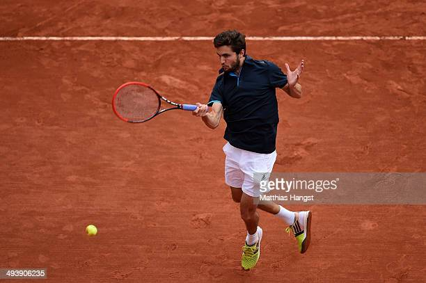 Gilles Simon of France returns a shot during his men's singles match against Ante Pavic of Croatia on day two of the French Open at Roland Garros on...